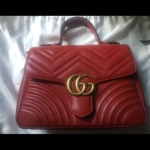 Gucci Small Marmont Top handle in Hibiscus red.